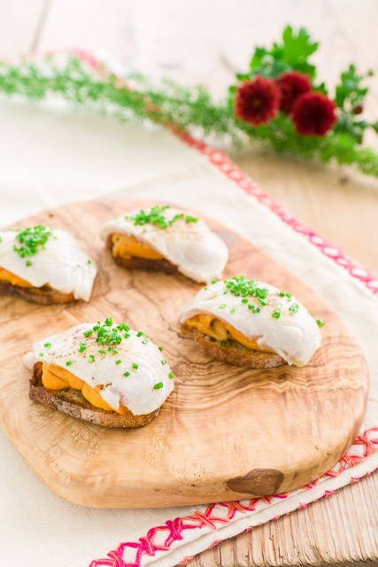 Crisp crostini topped with a mound of velvety uni and thin slice of Ivory King Salmon that's torched just long enough to melt the fat in it. #canape #appetizer # #horsdoeuvres #salmon