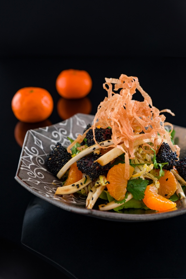 An Asian-inspired salad with marinated tuna encrusted in black sesame seeds with crisp fried spring roll wrappers, and mandarins, dressed with a ginger balsamic dressing. #salad #tuna #seafood #brunch #asian