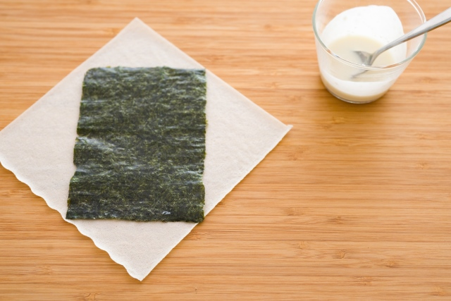 Use scissors to cut your nori into 3.5-inch x 4.75-inch sheets (you should have 8 sheets).