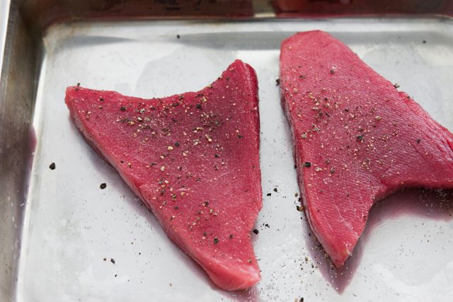 Generously salt and pepper both sides of the tuna and then dust with the flour