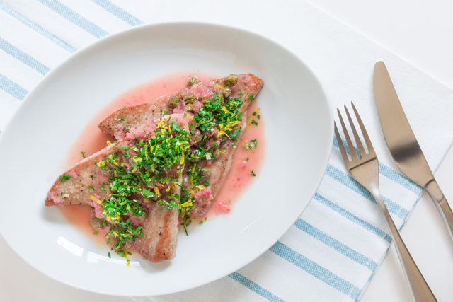 plate panfried tuna served with sauce and pile of gremolata