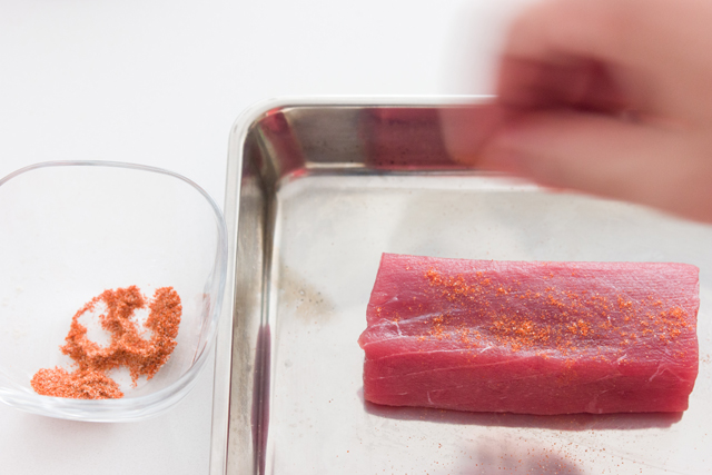 drain the pickling liquid into a container to hold the tuna