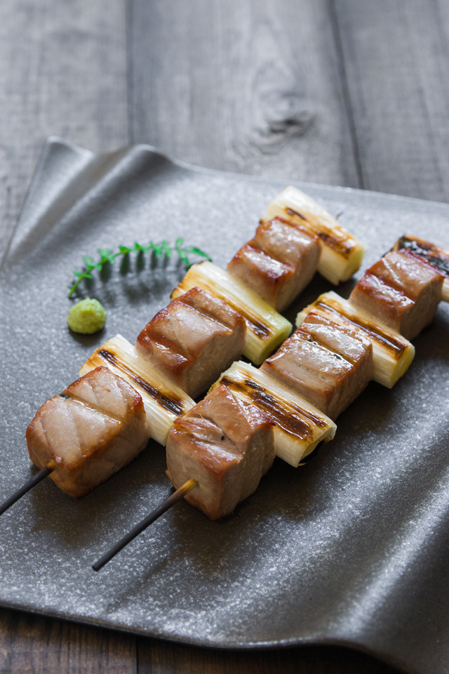 A playful take on Japanese yakitori with melt-in-your-mouth tender cubes of chūtoro (medium fatty tuna) grilled with smoky scallions. #tuna #japanese