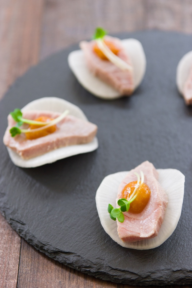 An easy one-bite canapé made with chutoro lightly poached in dashi stock, served over a crisp slice of daikon with a tangy yuzu miso sauce. #sashimi #japanese #japanesefood #japanesecuisine #japaneserecipe #shabushabu #instafood #foodie #recipe #recipes #seafood #canape #chutoro #tuna